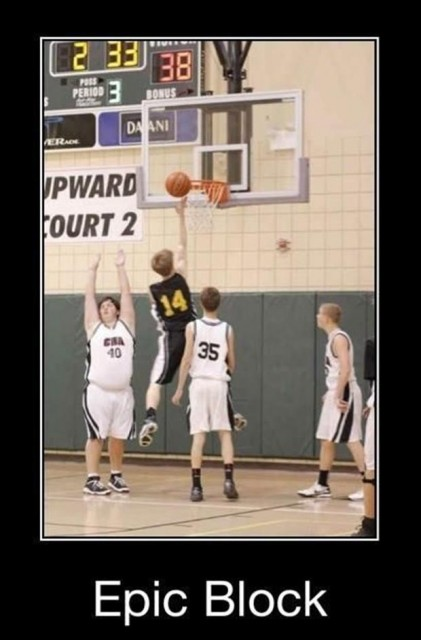 Fat kid playing basketball reaches up for epic block ...about three feet too far to the right.
